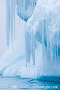 Icicles and melting ice, hanging from the edge of an blue iceberg.  Is this the result of climate change and global warming?, Brown Bluff
