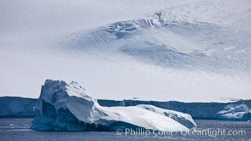 Iceberg and snow-covered coastline, Antarctic Sound. Antarctic Sound, Antarctic Peninsula, Antarctica, natural history stock photograph, photo id 24810