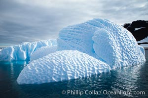 Iceberg with scalloped erosion.  The eroded indentations on this iceberg were melted when this portion of the iceberg was underwater.  As it melted, the iceberg grew topheavy, eventually flipping and exposing this interesting surface, Paulet Island
