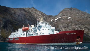 Hercules Bay, with icebreaker M/V Polar Star at anchor, below the steep mountains of South Georgia Island. Hercules Bay, South Georgia Island, natural history stock photograph, photo id 24553