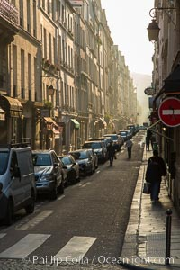 Rue de Ile Saint-Louis, early morning, Paris. Ile Saint-Louis is one of two natural islands in the Seine river, in Paris, France. The island is named after King Louis IX of France (Saint Louis). The island is connected to the rest of Paris by bridges to both banks of the river and by the Pont Saint Louis to the Ile de la Cite