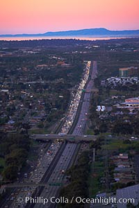 Interstate 805, rushhour traffic at sunset, looking north with the hills of Camp Pendleton and Oceanside in the distance, San Diego, California