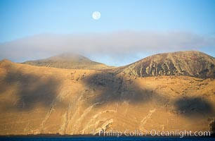 Arches on Isla Adentro and setting moon, daybreak, Guadalupe Island (Isla Guadalupe)