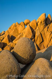 Jumbo Rocks at sunset, warm last light falling on the boulders, Joshua Tree National Park, California