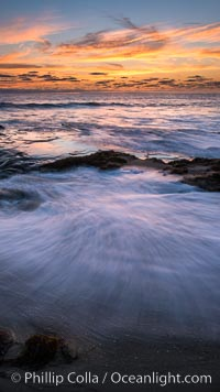 La Jolla coast sunset, waves wash over sandstone reef, clouds and sky, d 0.402760 0.496781