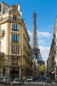 La Tour Eiffel. The Eiffel Tower is an iron lattice tower located on the Champ de Mars in Paris, named after the engineer Gustave Eiffel, who designed the tower in 1889 as the entrance arch to the 1889 World's Fair. The Eiffel tower is the tallest structure in Paris and the most-visited paid monument in the world