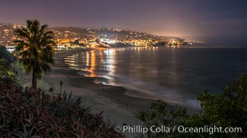 Laguna Beach coastline at night, lit by a full moon