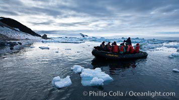 Landing ashore at Paulet Island, in an inflatable, at sunset. Paulet Island, Antarctic Peninsula, Antarctica, natural history stock photograph, photo id 24826