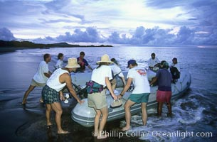 Land visit and sunset, skiff and tourists. Floreana Island, Galapagos Islands, Ecuador, natural history stock photograph, photo id 03474