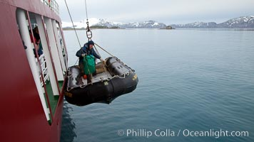 Launching a zodiac inflatable skiff boat, from the icebreaker M/V Polar Star, Salisbury Plain