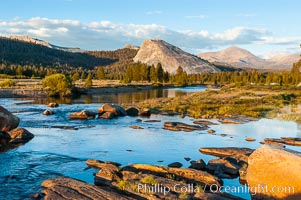 The Tuolumne River flows serenely through Tuolumne Meadows in the High Sierra. Lembert Dome is seen in the background, Yosemite National Park, California