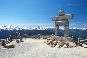 Ilanaaq, the logo of the 2010 Winter Olympics in Vancouver, is formed of stone in the Inukshuk-style of traditional Inuit sculpture.  This one is located on the summit of Whistler Mountain. Whistler, British Columbia, Canada, natural history stock photograph, photo id 21018