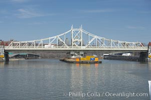 Macombs Dam Bridge.  Macombs Dam Bridge is a swing bridge that spans the Harlem River in New York City, connecting the boroughs of Manhattan and the Bronx near Yankee Stadium. It is the third-oldest bridge in New York City and was designated an official landmark in January of 1992. The bridge is operated and maintained by the New York City Department of Transportation