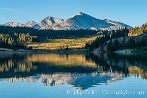 Mammoth Peak in the High Sierra range is reflected in Tioga Lake at sunrise. This spectacular location is just a short walk from the Tioga Pass road. Near Tuolumne Meadows and Yosemite National Park