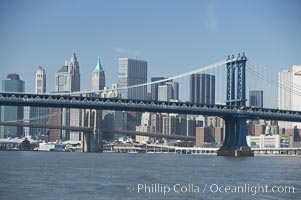 Manhattan Bridge viewed from the East River.  Lower Manhattan visible behind the Bridge, New York City