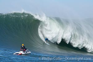 Grant Washburn (fifth place) gives the jetski photographer a show in the early rounds of the Mavericks surf contest, February 7, 2006. Mavericks, Half Moon Bay, California, USA, natural history stock photograph, photo id 15309