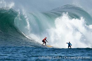 Tyler Smith (red) and Matt Ambrose (blue), final round, Mavericks surf contest, February 7, 2006, Half Moon Bay, California