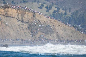 Mavericks surf contest crowd enjoys the sun and warm weather on the Pillar Point cliffs, February 7, 2006, Half Moon Bay, California