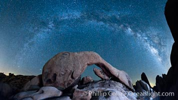 The Milky Way galaxy arcs above Arch Rock, panoramic photograph, spherical projection, Joshua Tree National Park, California