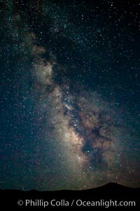 The Galactic Center of the Milky Way galaxy rises in the sky on a clear night