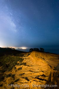 The Milky Way rises over La Jolla, viewed from Broken Hill in Torrey Pines State Reserve, San Diego, California
