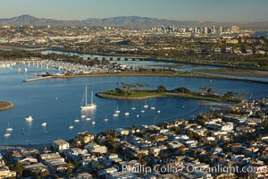 "Mission Bay is the largest man-made aquatic park in the country.  It spans 4,235 acres and is split nearly evenly between land and water.  It is situated between the communities of Pacific Beach, Mission Beach, Bay Park and bordered on the south by the San Diego River channel.  Once named ""False Bay"" by Juan Cabrillo in 1542, the tidelands were dredged in the 1940's creating the basins and islands of what is now Mission Bay"