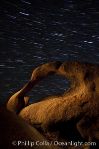 Mobius Arch in the Alabama Hills, seen here at night with swirling star trails formed in the sky above due to a long time exposure. Alabama Hills Recreational Area, California, USA, natural history stock photograph, photo id 27674
