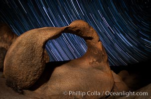 Mobius Arch in the Alabama Hills, seen here at night with swirling star trails formed in the sky above due to a long time exposure. Polaris, the North Star, is visible at upper right, Alabama Hills Recreational Area
