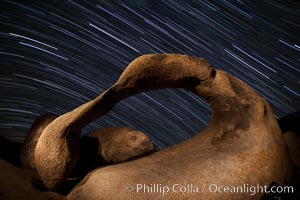 Mobius Arch in the Alabama Hills, seen here at night with swirling star trails formed in the sky above due to a long time exposure, Alabama Hills Recreational Area