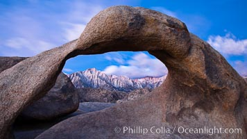 Mobius Arch at sunrise, framing snow dusted Lone Pine Peak and the Sierra Nevada Range in the background. Also known as Galen's Arch, Mobius Arch is found in the Alabama Hills Recreational Area near Lone Pine. Alabama Hills Recreational Area, California, USA