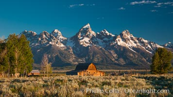 John Moulton barn at sunrise with Teton Range, on Mormon Row in Grand Teton National Park, Wyoming