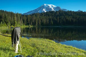 A photographer composes his image with a large view camera, Reflection Lake and Mount Rainier, Mount Rainier National Park, Washington