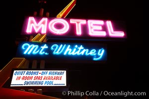 Mt. Whitney Hotel, near signs at night, Lone Pine, California