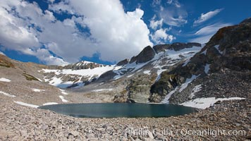 Nameless Lake, surrounded by glacier-sculpted granite peaks of the Cathedral Range, near Vogelsang High Sierra Camp, Yosemite National Park, California