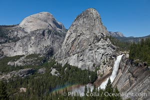 Half Dome and Nevada Falls, with Liberty Cap between them, viewed from the John Muir Trail / Panorama Trail.  Nevada Falls is in peak spring flow from heavy snowmelt in the high country above Yosemite Valley, Yosemite National Park, California