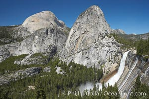 Nevada Falls, with Liberty Cap (center) and Half Dome (left). Nevada Falls marks where the Merced River plummets almost 600 through a joint in the Little Yosemite Valley, shooting out from a sheer granite cliff and then down to a boulder pile far below, Yosemite National Park, California