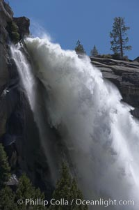 Nevada Falls marks where the Merced River plummets almost 600 through a joint in the Little Yosemite Valley, shooting out from a sheer granite cliff and then down to a boulder pile far below.,  Copyright Phillip Colla, image #16116, all rights reserved worldwide.