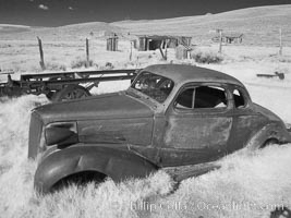 Old car lying in dirt field, Bodie State Historical Park, California