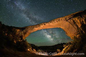 Owachomo Bridge and Milky Way.  Owachomo Bridge, a natural stone bridge standing 106' high and spanning 130' wide,stretches across a canyon with the Milky Way crossing the night sky, Natural Bridges National Monument, Utah