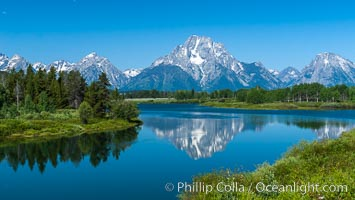 Mount Moran in the Teton Range is reflected in a sidewater of the Snake River at Oxbow Bend, summer, Grand Teton National Park, Wyoming