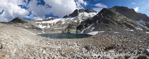 Panorama of Nameless Lake, surrounded by glacier-sculpted granite peaks of the Cathedral Range, near Vogelsang High Sierra Camp, Yosemite National Park, California, Keywords: yosemite, yosemite national park, high sierra, sierra nevada, landscape, california, environment, nature, outdoors, outside, scene, scenery, scenic, alpine, high sierra camp, sierra, vogelsang, lake, water, mountain, peak, backpack, backpacking, camp, campground, vogelsang high sierra camp, panorama, panoramic, panoramic photo, view, vista, wilderness, boulder, cirque, cliff, clouds, moraine, rock, sky, stone, tarn, talus, scree,  Copyright Phillip Colla, image #23211, all rights reserved worldwide.