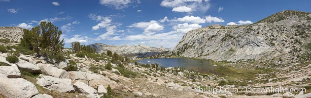 Panorama of Vogelsang basin, surrounding Vogelsang Lake in Yosemite's High Sierra, viewed from near Vogelsang Pass.  Left is Vogelsang Peak (11516'), Choo-choo Ridge is in the distant middle, and the western flank of Fletcher Peak is to the right, Yosemite National Park, California
