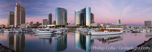 Panoramic photo of San Diego embarcadero, showing the San Diego Marriott Hotel and Marina (center), Roy's Restaurant (center) and Manchester Grand Hyatt Hotel (left) viewed from the San Diego Embacadero Marine Park