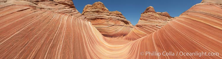 Panorama of the Wave.  The Wave is a sweeping, dramatic display of eroded sandstone, forged by eons of water and wind erosion, laying bare striations formed from compacted sand dunes over millenia.  This panoramic picture is formed from nine individual photographs, North Coyote Buttes, Paria Canyon-Vermilion Cliffs Wilderness, Arizona