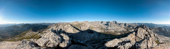Panoramic view of the Cathedral Range, from the summit of Vogelsang Peak (11500').  The shadow of Vogelsang Peak can be seen in the middle of the picture, Yosemite National Park, California