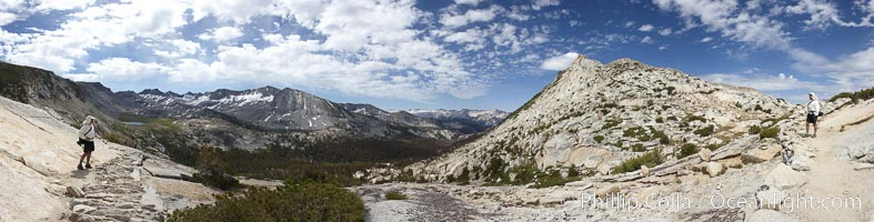 Panoramic view from Vogelsang Pass (10685')  in Yosemite's high country, looking south. A hiker appears twice in this curious panoramic photo, enjoying the spectacular view.  Visible on the left are Parson's Peak (12147'), Gallison Lake and Bernice Lake, while Vogelsang Peak (11516') rises to the right, Yosemite National Park, California
