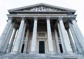 Pantheon. The Pantheon is a building in the Latin Quarter in Paris. It was originally built as a church dedicated to St. Genevieve and to house the reliquary chasse containing her relics but now functions as a secular mausoleum containing the remains of distinguished French citizens