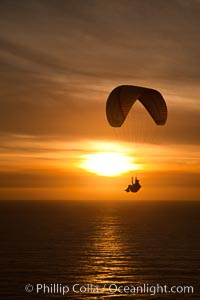 Paraglider soaring at Torrey Pines Gliderport, sunset, flying over the Pacific Ocean. La Jolla, California, USA, natural history stock photograph, photo id 24288