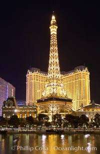 The half-scale replica of the Eiffel Tower at the Paris Hotel in Las Vegas is reflected in the Bellagio Hotel fountain pool at night