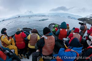 Photographers enjoy a crabeater seal, from two inflatable zodiacs in Cierva Cove